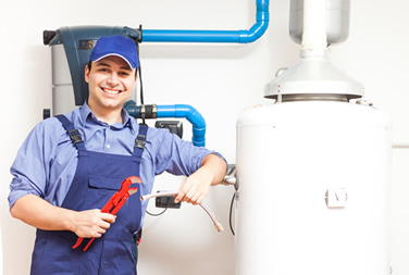 Plumbing contractor working on a hot water heater